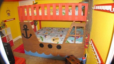 This Pirate Ship can sleep 5!  It has 2 full beds and a twin trundle bed!
