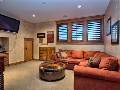 Spicewood estate rental - Game room with large television, oversized couch and computer for games.