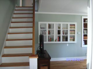 Winter Harbor house photo - Built-in bookcases and oak stairs to second floor
