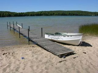 Honor cabin photo - Sandy beach and fishing boat has oars ready to row!