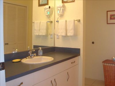 En suite bathroom with separate tub/shower & toilet area.