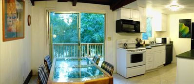 Cottonwood dining room and kitchen with a view to the deck, BBQ & walnut tree.