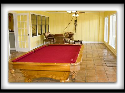 Amazing Sun Room with Pool Table and Sitting Area