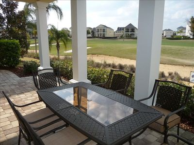 Patio with full dining set overlooking golf course