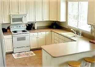 The spacious gourmet kitchen is adjacent to the dining room that seats 8!