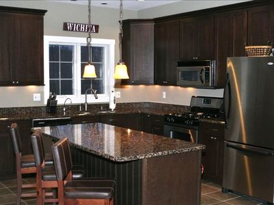 Chef's Kitchen - Flows into the dining area and living room