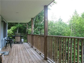 Covered porch - great for reading, grilling, and dining al fresco!