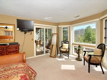 Master bedroom offers flat screen tv, access to screen porch and mountain view