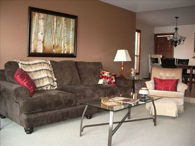 Living Room/Dining area is spacious and well furnished with wonderful lakeviews