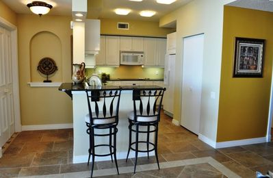 Kitchen & Breakfast Bar features Granite Counters & Equipped for Gourmet Meals.