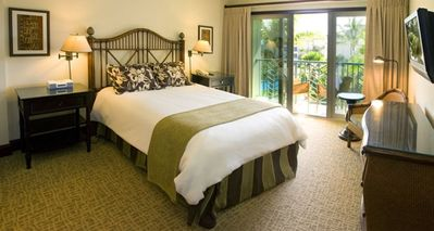 The queen master suite bedroom has its own lanai for watching the surf.