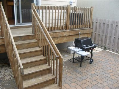 Rear deck with enclosed private back patio