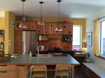 Haines house rental - Open, sunny kitchen made of copper, fir and birch.