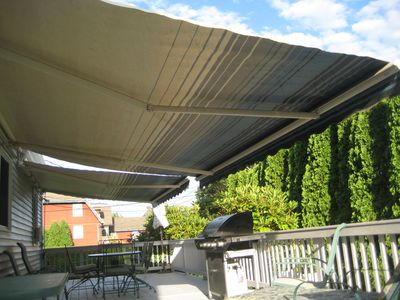 Huge dual awnings extend over deck. Perfect protection from sun or sprinkles.