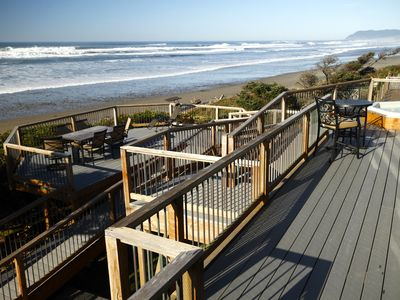 Deck overlooking Arch Cape Beach with ramp coming from lower level of house.