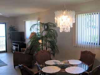 Sanibel Island condo photo - Capiz chandelier highlights dining area