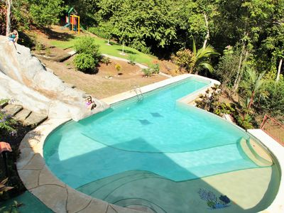 Huge pool w/ swim and slide. My 2 children show size of slide/ pool. Junglegym