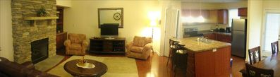 Panoramic view of family room w/ stone fireplace