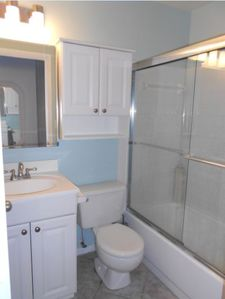Clean bathroom with plenty of storage for toiletries