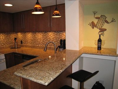 Entertain or enjoy a prepared meal in the fully equipped kitchen