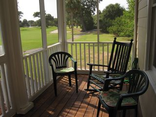 Wild Dunes house photo - Screened in porch overlooks the Links course