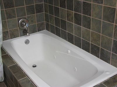 Large garden tub in master bath upstairs. Also stained glass and vaulted.