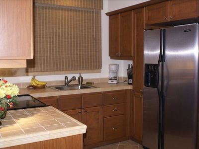 Los Suenos Resort condo rental - Kitchen with pass thru window above sink. Washer and Dryer also in kitchen.