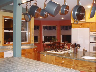 Fully equipped large gourmet kitchen with an adjoining breakfast nook