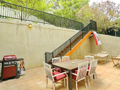 Another angle of the lower patio: Large outside dining table
