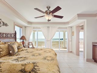 St. Augustine cottage photo - Luxury master bedroom with king bed, ocean views & wet bar