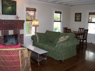 Cortez cottage photo - Airy open plan living-dining room area with fireplace.