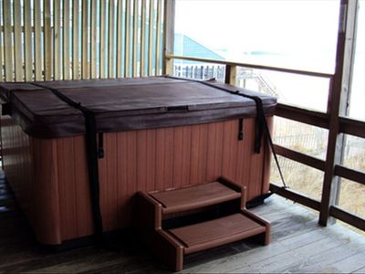 6 person hot tub on back deck over looking the ocean