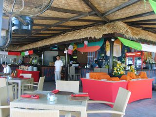 Nusa Dua apartment photo - Restaurant at the beach