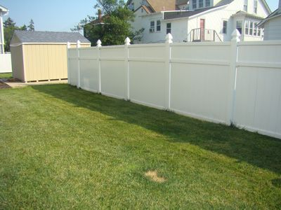 Nice and private backyard, green grass and white vinyl fencing for your privacy.