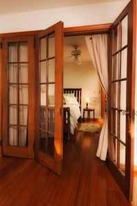 restored french doors lead into 2nd bedroom w/twin bed & delux mattress