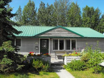 Anchorage house rental - Welcome! Rental suite is in back. It has forest view, private access & trails!