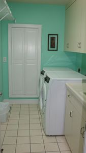 Laundry room with front load washer and dryer