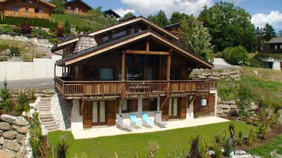 Chalet Renard Blanc is a luxurious yet cosy home for skiing , golf and hiking.