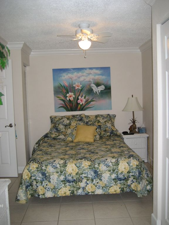 Queen bed with small TV and DVD