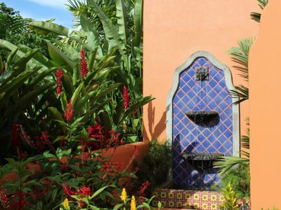 Mexican wall fountain adds delightful sound and color to the courtyard garden
