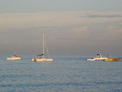 Katamaran and other vessels used for snorkeling scuba-diving sunset cruises