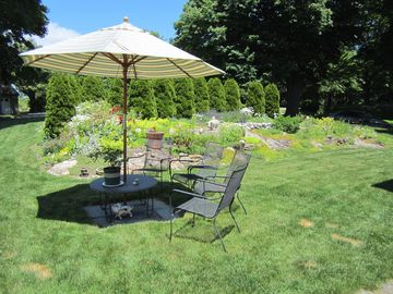 Summer garden in peak season. Common outdoor seating for guests.
