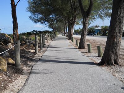 Walk, jog or bike on miles of beachside trail just half a block away.