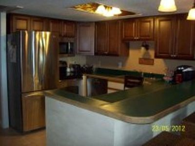 Windy Hill condo rental - Kitchen showing new stainless steel appliances and new cabinetry