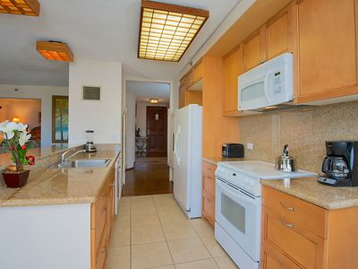 Roomy kitchen with a view of the coean