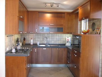 Fully Equipped Modern Kitchen with 5 burner gas range