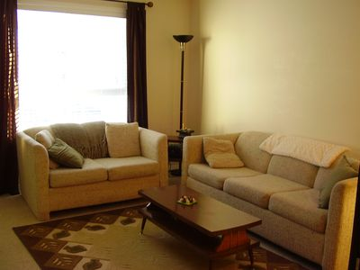 Living room with three seater pull out couch