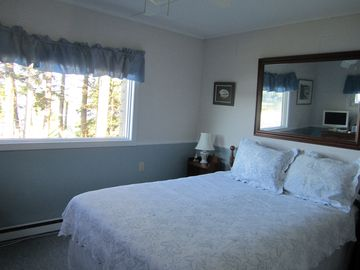 Master bedroom; there's a large closet to the right of the bed; also small TV