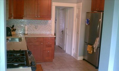 Entering the kitchen from the back door. Hallway leads to bathroom