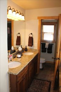 Master bath offers double sinks with granite countertops and bronze fixtures